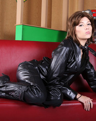 Nicole Ray strips off her hot black leather pants to show her pussy