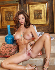Emily Addison inserts a dildo against her aroused clit