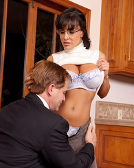 Busty brunette MILF Lisa Ann sucks and rides a dick in the kitchen