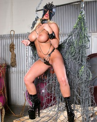 Blond Candy Mason showing her big tits with chains wrap around her body